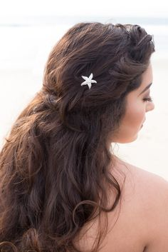 Silver Rhinestone & Pearl Starfish Beach Bridal Hair Pin Accessory  THIS PIN IS SOLD INDIVIDUALLY! More than one pictured for aesthetic purposes.  This star fish beach bridal hair pin is fixed to a non-tarnishing, rhodium plated straight hair pin. The small freshwater pearl cluster center makes for a gorgeous, beachy design.This simple, yet elegant sea star pin is approximately 1. Also available without pearl center (all rhinestone).  PLEASE READ OUR POLICIES, PROCEDURES, & SHIPPING INFORMATI...