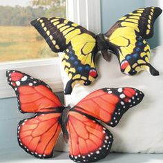 """Beautiful Butterfly Pillows  Catch several to scatter on your sofa, window seat or bed. Larger-than- life sculptures of soft polyester, printed in realistic patterns from nature and plumped with polyester fill. Spot clean. Imported. 19""""w, 12""""h."""