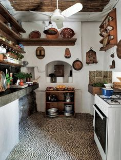 The kitchen, with counters of local stone and antique Lindian ceramics.