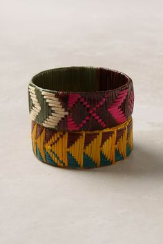 These woven bracelets feature vibrant reinterpretations of traditional African fabric patterns, repurposed by master weavers in Rwanda. Handmade by artisans of the Bluma Project, which supports women's employment in cooperatives throughout the world.