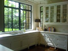 dream kitchen, open and airy, has a historic feel with the lower white cabinet, glass uppers, black grid windows.