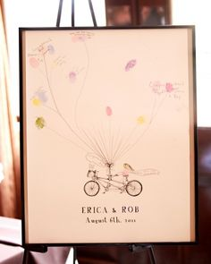"""The Guest Book  A poster by Bleu de Toi featuring the couple's names, wedding date, and a bicycle built for two served as their guest book. Guests were encouraged to create """"balloons"""" with their inked-up thumbs."""