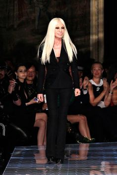 Donatella Versace comes out to greet the audience after showcasing her Atelier Versace Spring/Summer 2014 Couture Collection | January 19, 2014; Paris