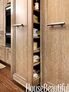 "Limed Oak Limed-oak cabinetry was designed by M Group: ""There's a flatness to the look of the oak that helps the kitchen feel more modern."""