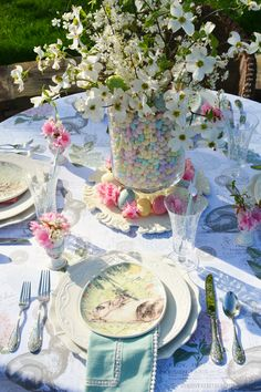 Alfresco Easter Table with easy and festive centerpiece of jelly beans, dogwood and plum tree blossoms | homeiswheretheboatis.net