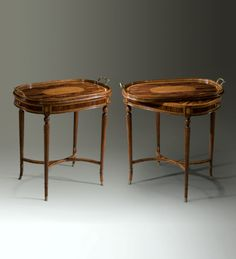 A wild rosewood and satinwood banded tray top table, the oval tray top with a zigzag veneered gallery and brass handles, with a sycamore, rosewood and satinwood chess and backgammon board below and a further leather inlaid backgammon well below, on spiral turned legs joined by an 'X' stretcher, with fine brass feet. Theodore Alexander, Luxury Furniture Brands, English Heritage, Brass Handles, Chess, Bar Stools, Spiral, Tray, Gallery