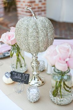 Disney brides, take note of this Cinderella-inspired pumpkin centerpiece. Warning: lots of glitter ahead for this modern DIY wedding idea. wedding centerpieces 13 DIY Wedding Ideas for Unique Centerpieces - mywedding Disney Wedding Centerpieces, Fall Wedding Decorations, Wedding Themes, Cinderella Centerpiece, Cinderella Decorations, Quince Decorations, Quinceanera Centerpieces, Cinderella Quinceanera Themes, Wedding Dresses