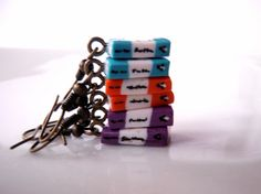 Penguin Book Dangle Earrings in Orange by Coryographies (Made to Order). £6.00, via Etsy.