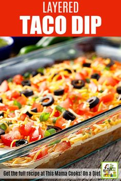 This tasty 7 Layer Taco Dip recipe is packed with layers of ground beef, refried beans, cream cheese, shredded cheese, tomatoes, sour cream, green onions, and more! Add your favorite toppings like avocados and olives. 7 Layer Taco Dip, Bean Dip Layer, 7 Layer Taco Salad Recipe, Easy Taco Dip, Seven Layer Dip, Bean Dip Recipes, Mexican Dip Recipes, Mexican Dips, Mexican Meals