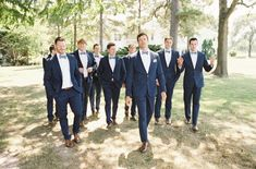 navy groomsmen outfits, navy suits with blue bow ties http://itgirlweddings.com/sailboat-nautical-wedding/