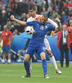 Leonardo Bonucci of Italy controls the ball under pressure of Alvaro Morata of Spain during the UEFA EURO 2016 round of 16 match between Italy and Spain at Stade de France on June 27, 2016 in Paris, France.
