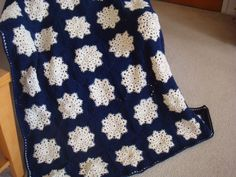 My first Snowflake Granny Square Afghan done with Ivory Sparkle Centers and Navy