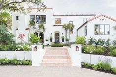 new exterior painted white with grand entrance - benjamin moore ultra bright White Dove.