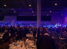 2014-10-24: Glow sticks light up as Hillary Clinton enters the Iowa Democrats annual Jefferson-Jackson Dinner.
