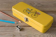 The Danica Studio Bicicletta Box is perfect for storing pens, pencils and small accessories in one trusty place. Pencil Boxes, Tin Boxes, Pens, Organize, Stationery, Organization, Studio, Accessories, Getting Organized