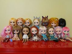 Front row, left to right: Pinkie (R's Basaak), Snowden (ADG Roaring Red), Ginger (PD Ginger), George (Friendly Freckles), Fleur (Simply Vanilla), Victoria (Very Vicky), Margo (R's Basaak), Nymph (Simply Guava); Back row, left to right: Ginny (Simply Mango), Luna (Mademoiselle Rosebud), Pansy (Fruit Punch), Sparrow (Angelica Eve), Alicia (Basaak), Lilith (Factory), Angelina (Blybe) ~ From http://pandorasdolls.blogspot.co.uk/2011/09/my-plastic-family.html