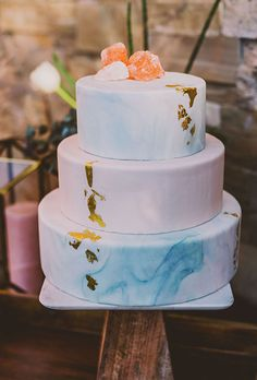 Brides.com: . Swirls of watercolor-like frosting are both modern and whimsical.