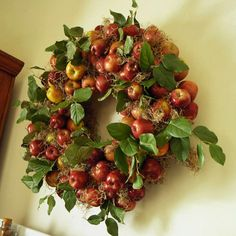 Harvest Apples Wreath-like the Spanish moss as filler. Various bows could make this work for fall or Christmas.