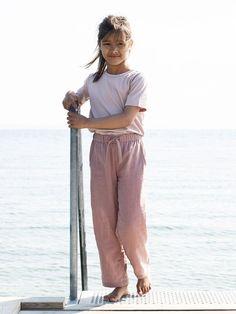 Pantaloni copii din bumbac organic certificat GOTS.Pantalonii sunt prevăzuți cu snur in talie pentru o  îmbrăcare mai ușoară și 2 buzunare încăpătoare.   Un material ușor, moale fapt ce face ca pantalonii să fie foarte confortabili pentru vară sau toamnă.  Mărimi disponibile: de la 3 ani (98 cm) până la 6 ani (116 cm).  Compoziție: 100% bumbac organic. Serendipity, Claire, Jumpsuit, Organic, Pants, Dresses, Fashion, Overalls, Trouser Pants