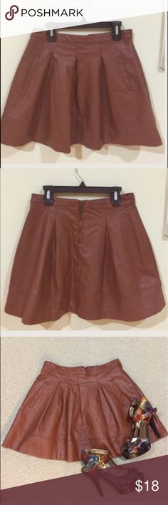 Forever 21 brown faux leather skirt gently worn , size S , 15 inches from top to bottom, not leather, very cute on, front pockets , has lining , 🌟REASONABLE OFFeRS ACCEPTED🌟 👍🏼BUnDLE AND SAVE👍🏼 Forever 21 Skirts