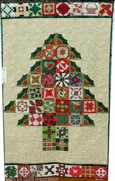 Dear Jane Christmas Tree quilt by Netty Soares, quilted by Suzi Dillinger.  2013 DVQG.  Photo by Quilt Inspiration