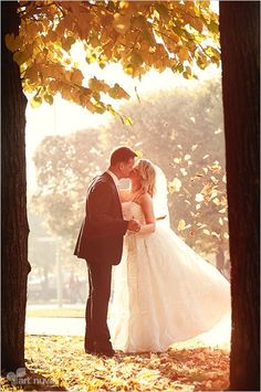 Wedding picture - Young couple of autumn leaves