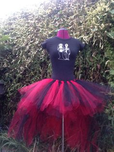 This tutu can be made in any color or size. It has a 14 inch length skirt that is extra fluffy quadrupled tied layers of tulle. The attached
