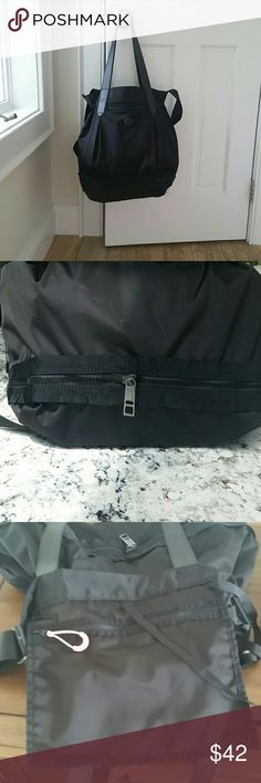 Lululemon Black, nylon shoulder or cross-body bag All black bag qith large zipper attached zipper pocket inside. Front phone pocket. Has firm leather like shoulder straps or adjustable cross body style strap. Cinch and tie closure,  Zippered bottom extends bag a few inches for more depth.  Used once or twice.  Perfect condition. lululemon athletica Bags Shoulder Bags