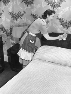 Housewife dusting bedroom.cleaned house every Saturday