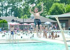 Dakota West, 10, of New Philadelphia, beat the heat Wednesday by having fun at the Tuscora Park pool.