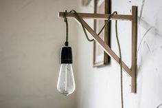 Wooden wall sconce. Handmade lamp with porcelain bulb holder, wood bracket and fabric cable