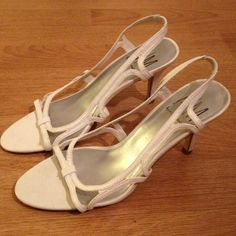 ANN MARINO White Slingback Heels Sz 7.5 Worn a handful if times. Still in very good condition. Price firm. $5 if bundled. Ann Marino Shoes Heels