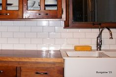 "Google search for subway+tile+""light gray grout"" (this image is from bungalow23: http://bungalow23.com/2012/02/22/subway-tile-backsplash-installed/ )"