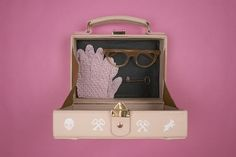 Artist Jayde Fish creates hand-painted train case purses inspired by 'The Grand Budapest Hotel,' 'The Royal Tenenbaums,' and more.