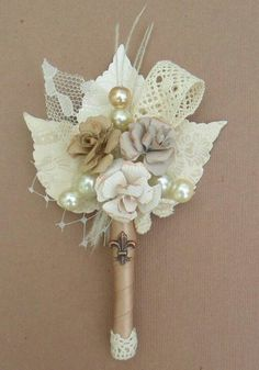 "boutonniere, strip of lace included in arrangement, ""sock"" for the bottom tip"