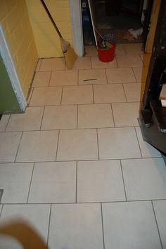 The benefit of snatching a handful of hours over the last week to cut, lay, and grout tile on my basement floor, is that I can now share with you the deep, dark mysteries of laying floor tile. With...