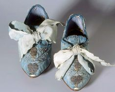 Children's shoes, Zurich, 1750. Blue silk, pointed shape, silver embroidery, with wide mesh. Silk damask, leather.  Swiss National Museum