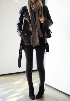 Black pants, ankle booties, leather jacket and add color with a chunky scarf.