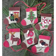 The Warm Feet Felt Christmas Ornament Kit from Rachel's of Greenfield makes 6 unique stocking ornaments. Kit includes felt, embroidery floss for embellishment, gold string for hanging, complete patterns, and illustrated instructions. Colors are sandstone, red, brown, green, gold, white and black. Each ornament features a unique design motif on the front.