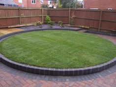 Garden Design Circular Lawns three-quarter round lawn curves around a deck with a rounded edge