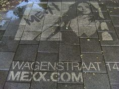 GreenGraffiti. This is actually a dutch company, making graffiti art by CLEANING rather than using spray paint.