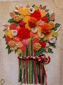 needlepoint bouquet of flowers with button embellishments