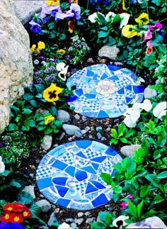 creating mosaic stepping stones from plain concrete ones available at any retailer in the garden dept.
