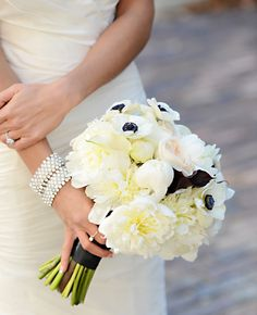This Black and White Bridal Bouquet with Anemones, White Calla Lilies and Cafe au lait Dahlias