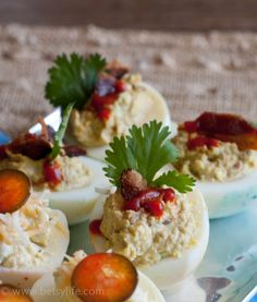 Bacon, avocado and Sriracha Deviled Eggs. Perfect for brunch