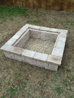 Our backyard firepit. 1. Dig a square hole six inches deep. 2. Fill flat layer of landscape gravel. About 3 inches deep. *** Use fire resistant cement in tube to glue each layer. Just put in top. No need in between. 3. On top of gravel use rectangle, flat pavers (16) to line edge of whole; flush with ground. 4. Each layer is 16 rectangle block payers interlocked. Three layers tall. 5. Top with 16 flat, rectangular pavers slightly of edge. Two square pavers create extra space.