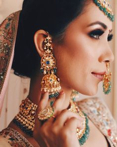 Elegant polki jhumkis with baby pearls and embellished stones paired perfectly with an offwhite lehenga is a great look for your intimate wedding! (C) Deepika's Deep Clicks #wittyvows #indianwedding #indianbride #bridaljewellery #indianbridaljewellery #bridalearings #jewelryforwomen #indianweddinginspiration #weddingideas #bridalaccessories #bridallehenga