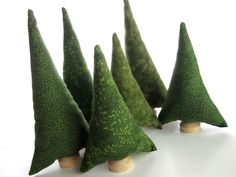Evergreen Trees Tiny Forest - Natural Evergreen Pine tiny forest of 6 Christmas tree plush toy fabric trees. $18,00, via Etsy.