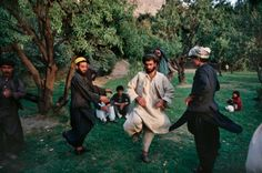 Afghan men in Kabul's Babur Gardens perform an attan dance, a traditional dance, during a Friday picnic. September, 1991 Robert Nickelsberg