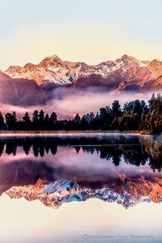 Sunrise Reflection of Aoraki/Mount Cook & Mount Tasman on Lake Matheson ~ Near the Fox Glacier in South Westland, New Zealand